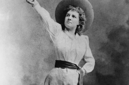 Annie Oakley pointing a handgun in the air