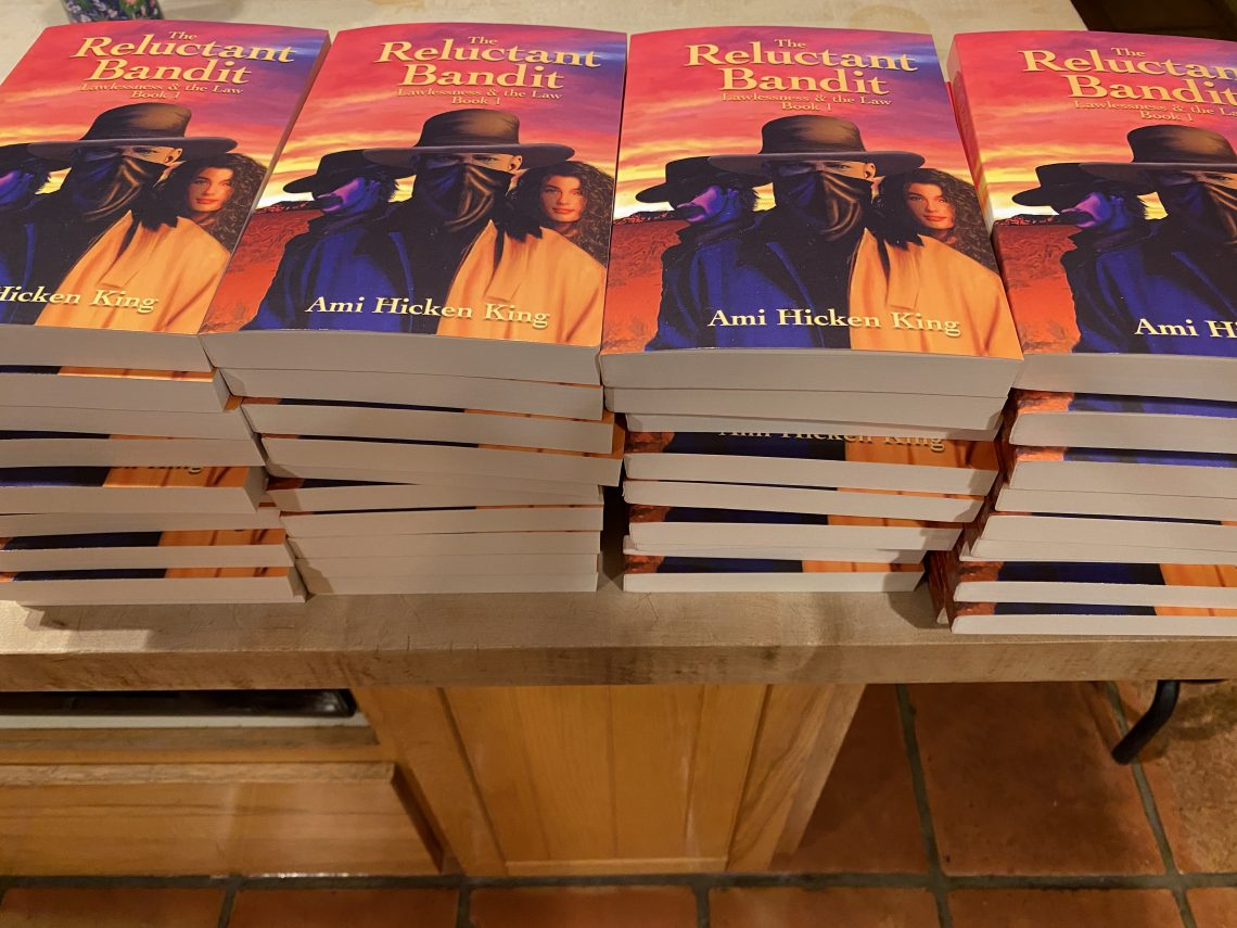 40 copies of The Reluctant Bandit on a kitchen island